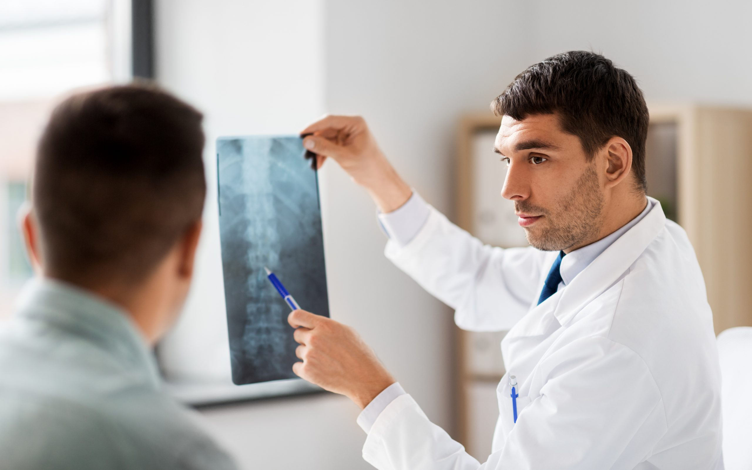 Chiropractor Evaluating x-ray